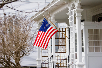 Old House with American Flag in small village in Central New York State.